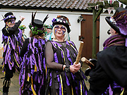 Rack-a-back Morris Men dancing a stick dance at an orchard-visiting wassail in Kilham village, Yorkshire Wolds, UK on 21st January 2017. Wassail is a traditional Pagan winter celebration in cider-producing regions of England, reciting incantations and singing to the trees to promote a good harvest for the coming year. Pieces of toast soaked in cider are hung in the branches to attract robins to the tree as these are said to be the good spirits of the orchard. To ward off evil spirits, villagers scare them away by banging pots and pans and making as much noise as possible