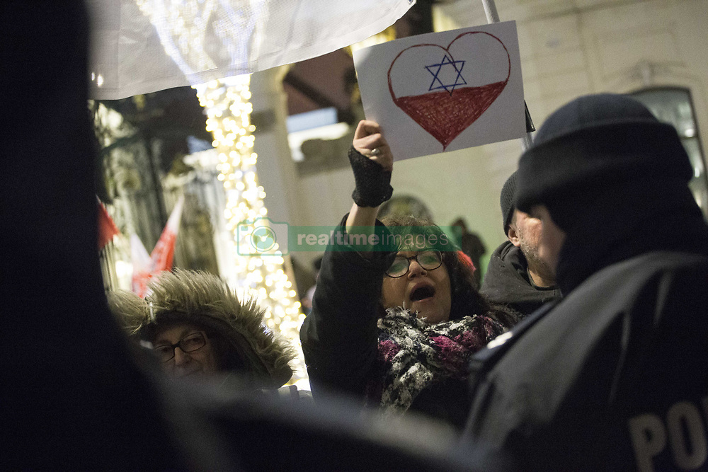 February 5, 2018 - Warsaw, Poland - Contrmanifestation to far-right protest near Presidental Palace in Warsaw on February 5, 2018.. Manifestation organized by Far-Right groups to protest against reaction of the Israeli authorities to the law introducing the penalty for using the term ''Polish death or concentration camps' (Credit Image: © Maciej Luczniewski/NurPhoto via ZUMA Press)