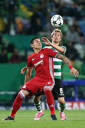 November 22, 2017 - Lisbon, Portugal - Sporting's defender Fabio Coentrao from Portugal (R ) fights for the ball with Olympiacos' Serbian forward Uros Djurdjevic during the UEFA Champions League group D football match Sporting CP vs Olympiacos FC at Alvalade stadium in Lisbon, Portugal on November 22, 2017. Photo: Pedro Fiuza  (Credit Image: © Pedro Fiuza/NurPhoto via ZUMA Press)