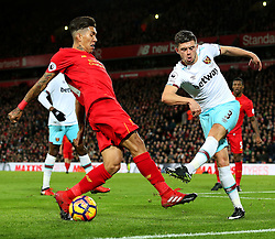 Aaron Cresswell of West Ham United clears the ball under pressure from Roberto Firmino of Liverpool - Mandatory by-line: Matt McNulty/JMP - 11/12/2016 - FOOTBALL - Anfield - Liverpool, England - Liverpool v West Ham United - Premier League