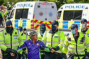 Police detain an anti-migrant protester during a demonstration against immigration and the increase in journeys made by refugees crossing the English Channel in dinghies to the UK on Saturday, Sept 5, 2020 - in Dover, England. The demonstrators blocked the main dual carriageway into the port after an earlier demonstration by migrant supporters in the town's Market Square. At least 100 officers were at the scene on the A20 while protesters block the road and shout 'England 'till I die'. Fears of violence were voiced and local MP Natalie Elphicke pleaded for people to 'stay away' over COVID fears. (VXP Photo/ Vudi Xhymshiti)