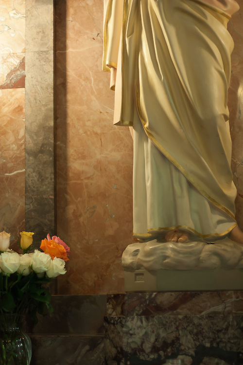 Chapel with roses and statue of Christ.