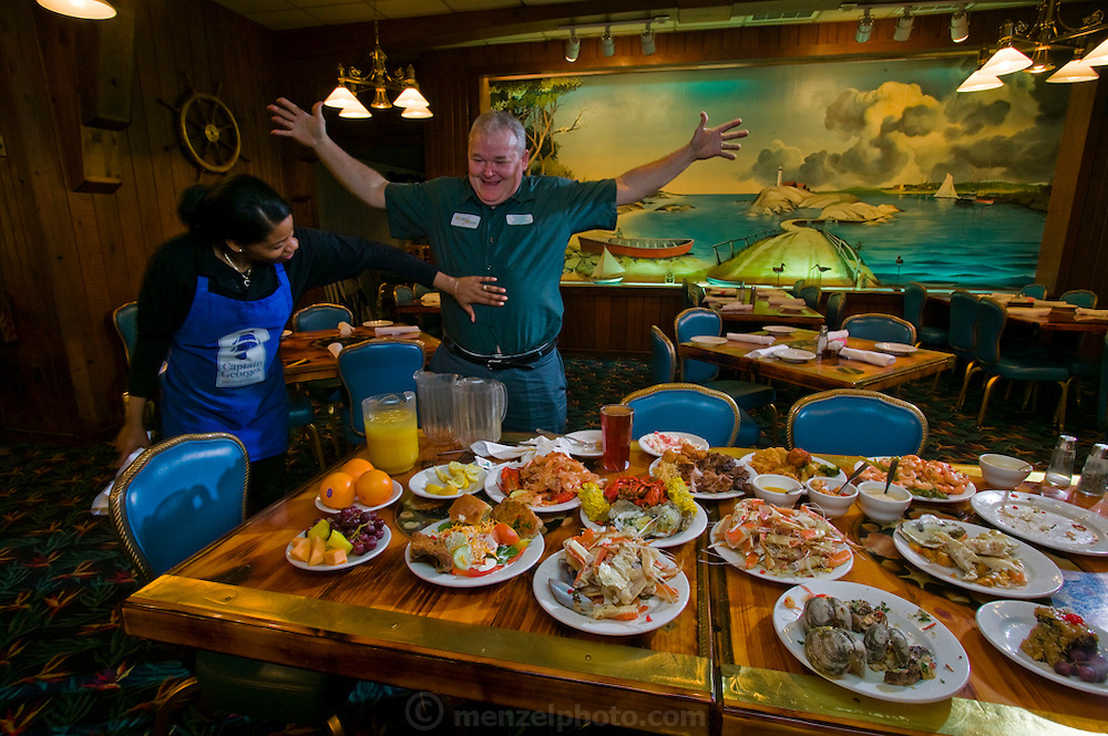 Carson 'Collard Green' Hughes Eating at an all you can eat seafood buffet in Newport News, Virginia, in preparation for a contest. He died at 44 in December 2008. (Carson 'Collard Green' Hughes is mentioned in the book What I Eat: Around the World in 80 Diets.)  MODEL RELEASED.