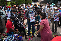 As the result of the trial of David Cáceres is awaited at the Supreme Justice Court, for his part in the assassination of Lenca leader Berta Cáceres, Lenca and Garifuna offerings are made in the street. People carry posters that say #castilloculpable and light incense, candles and tobacco