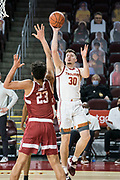 Southern California Trojans guard Noah Baumann (30) shoots over Stanford Cardinal froward Brandon Angel (23) during an NCAA men's basketball game, Wednesday, March 3, 2021, in Los Angeles. USC defeated Stanford 79-42. (Jon Endow/Image of Sport)