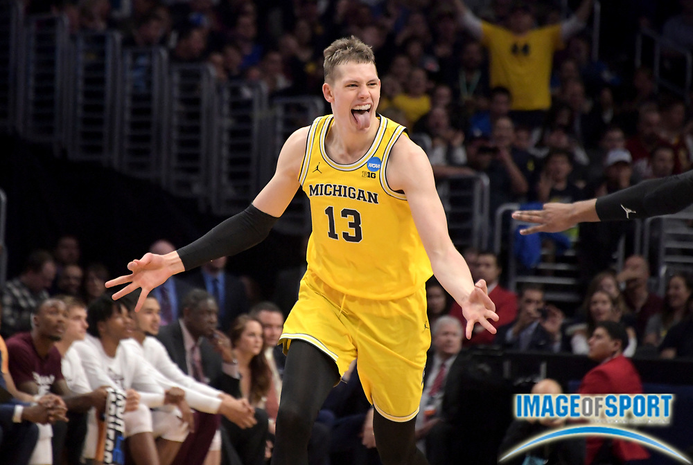 Michigan Wolverines forward Moritz Wagner (13) celebrates in the first half against the Texas A&M Aggies during a West Regional semifinal of the NCAA men's college basketball tournament, Thursday, March 22, 2018, in Los Angeles. Michigan defeated Texas A&M 99-72.