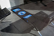 With a further 154 covid deaths reported in the last 24hrs, bringing the total to 43,081 in the UK during the Coronavirus pandemic, seating and social distancing markers on the floor of a business address entrance in Conduit Street in Mayfair, on 24th June 2020, in London, England.