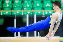 Luka Kisek of Slovenia competes in the Pommel Horse during Qualifiying day  of Artistic Gymnastics World Challenge Cup Ljubljana, on April 18, 2014 in Hala Tivoli, Ljubljana, Slovenia. Photo by Vid Ponikvar / Sportida