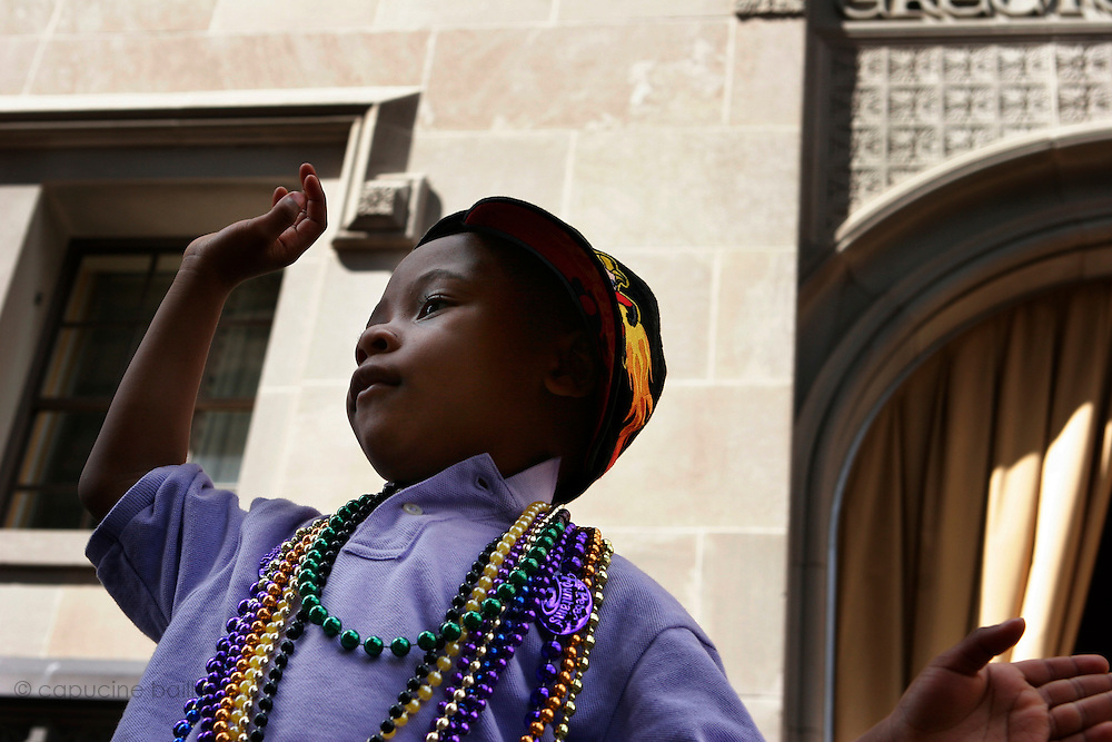 February 28th 2006. New Orleans, Louisiana. United States..A kid asks for beads at the Zulu Mardi Gras morning Parade on Saint Charles Avenue.