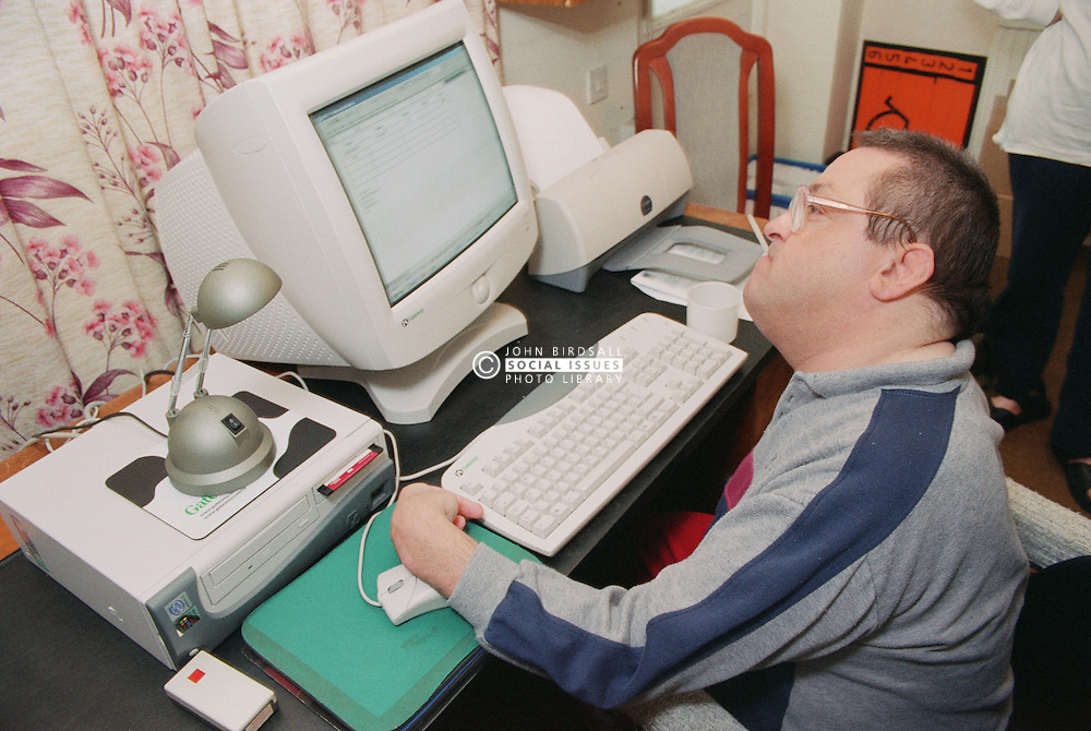 Man with Cerebral Palsy using computer,