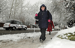 © under license to London News Pictures. 1.12.2010 Snow chaos in Orpington in Kent.  Janet Twyman who is a district nurse walking down Station Road, Orpington. Picture credit should read Grant Falvey/London News Pictures