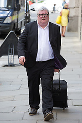 Image ©Licensed to i-Images Picture Agency. 04/07/2014. London, United Kingdom. Greg Miskiw arrives for sentence. Former news editor of the defunct British tabloid newspaper the News of the World Greg Miskiw  arrives today for sentencing in the phone hacking trial at Old Bailey. Picture by Daniel Leal-Olivas / i-Images