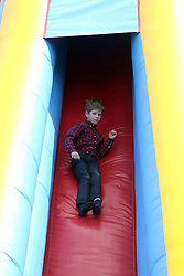 James, Viscount Severn son of the Earl and Countess of Wessex, goes on a slide during the Royal Windsor Horse Show, which is held in the grounds of Windsor Castle in Berkshire.