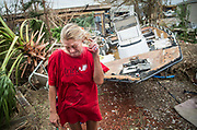 "Melani Zurawski cries while inspecting her home on Sunday, Aug. 27, 2017, in Port Aransas, Texas. Zurawski was one of the few residents who hunkered down in Port Aransas when Hurricane Harvey, boasting winds of 140-MPH, ripped through the coastal city. ""We thought we were all going to die,"" Zurawski said. NICK WAGNER / AMERICAN-STATESMAN"