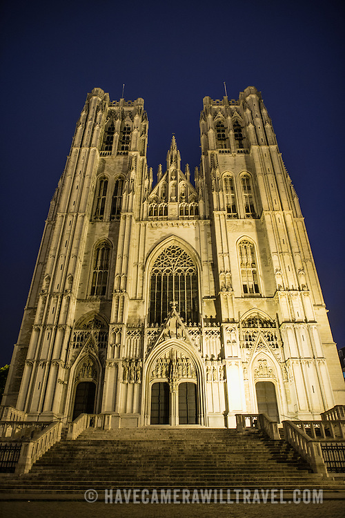 Night shot of the Cathedral of St. Michael and St. Gudula (in French, Co-Cathédrale collégiale des Ss-Michel et Gudule). A church was founded on this site in the 11th century but the current building dates to the 13th to 15th centuries. The Roman Catholic cathedral is the venue for many state functions such as coronations, royal weddings, and state funerals. It has two patron saints, St Michael and St Gudula, both of whom are also the patron saints of Brussels.