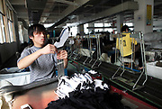 Workers make socks at the Shuangjin Knitting & Textile Co. in Zhuji, Zhuji Province, China on 01 November 2010. The rising cost of labor and raw materials along with the rising Yuan have hurt China's export oriented manufacturers.
