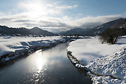 River flowing through Tadami, Nekka Shochu Distillery, Tadami, Fukushima, Japan, February 22, 2018. The Nekka shochu distillery was founded in July 2016 and at that time was the smallest shochu distillery in Japan. It makes shochu from locally-grown rice, and is helping support a local economy that has languished since the nuclear disaster of 2011.