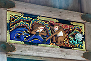 """""""A new couple embarks on life together, facing a tidal wave of trials and tribulations,"""" in one of 8 panels of art work on a storehouse in Toshogu shrine in Nikko, Japan. Hidari Jingoro may have carved these panels to incorporate Confucius's Code of Conduct, using the monkey as a way to depict man's life cycle. The monkeys are Japanese macaques, a common species in Japan. Toshogu Shrine is the final resting place of Tokugawa Ieyasu, the founder of the Tokugawa Shogunate that ruled Japan for over 250 years until 1868. Ieyasu is enshrined at Toshogu as the deity Tosho Daigongen, """"Great Deity of the East Shining Light"""". Initially a relatively simple mausoleum, Toshogu was enlarged into the spectacular complex seen today by Ieyasu's grandson Iemitsu during the first half of the 1600s. The lavishly decorated shrine complex consists of more than a dozen buildings set in a beautiful forest. Toshogu contains both Shinto and Buddhist elements, as was common until the Meiji Period when Shinto was deliberately separated from Buddhism. Toshogu is part of Shrines and Temples of Nikko UNESCO World Heritage site."""