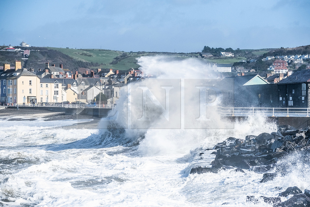 © Licensed to London News Pictures<br /> Aberystwyth Wales UK  09/03/2019.<br /> Gale force winds gusting at over 60mph and the  morning's high tide  combine, bringing huge waves sweeping across the Irish Sea  to batter the sea defences  at  Aberystwyth on the Cardigan Bay coast, West Wales UK. Photo credit: Keith Morris / LNP