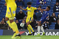AFC Wimbledon midfielder Tyler Burey (32) holding off Juan Castillo of Chelsea (54) during the EFL Trophy match between U21 Chelsea and AFC Wimbledon at Stamford Bridge, London, England on 4 December 2018.