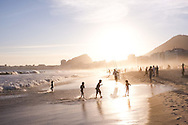 Kids playing in the water, Copacabana Beach at Sunset, Rio de Janeiro, Brazil