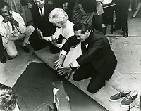 1963 Paul Newman and Joanne Woodward at their hand and footprint ceremony at Grauman's Chinese Theater