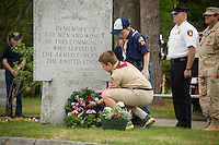 Boy Scout Ken Valentine and Cub Scout Micha Fay lay the wreath at the armed services monument during Memoiral Day services at the Gilford Cemetery Monday morning.   (Karen Bobotas/for the Laconia Daily Sun)
