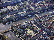 Nederland, Noord-Holland, Amsterdam; 23-03-2020; overzicht binnenstad Amsterdam, Nieuwmarktbuurt. Voorgrond Oude Waal, Montelbaanstoren en Oude Schans. <br /> Het publieke leven in het centrum van de hoofdstad is bijna geheel stil komen te liggen als gevolg van het Corona virus. Niet alleen is alle horeca dicht, ook veel winkels en andere bedrijven zijn gesloten. Het publiek blijft over het algemeen binnen, de straten en pleinen zijn stil.<br /> Innercity Amsterdam, New market.<br /> Public life in the center of the capital has come to a complete standstill as a result of the Corona virus. Not only are all pubs, coffee shops and restaurants,  closed, many shops and other companies are also closed. The public generally stays inside, the streets and squares are very quiet.<br /> <br /> luchtfoto (toeslag op standaard tarieven);<br /> aerial photo (additional fee required)<br /> copyright © 2020 foto/photo Siebe Swar