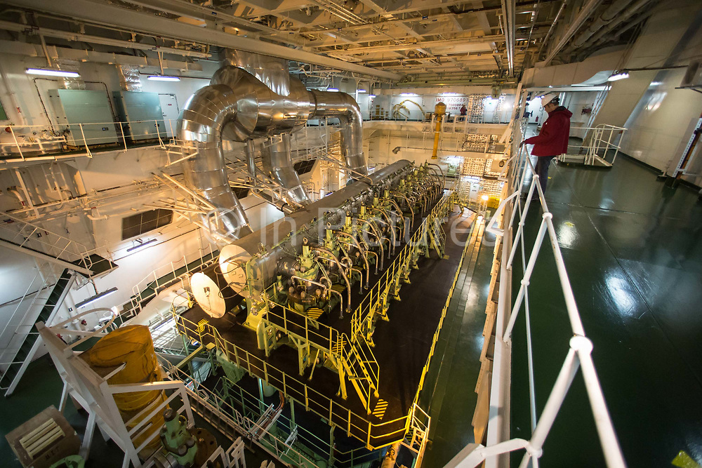 A crew member walks through the engine room of CMA CGM SAs Benjamin Franklin container ship as it sails off the coast of southern China, on Sunday, Jan. 31, 2016. The Benjamin Franklin is the largest container ship ever to have docked at a U.S. port.