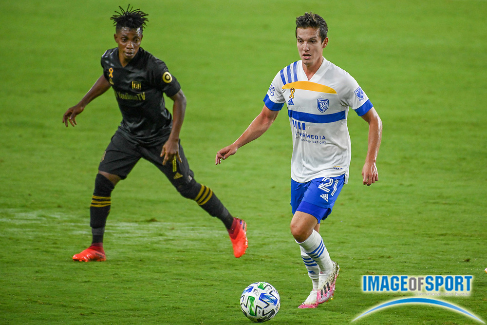 LAFC forward Latif Blessing (7) chases San Jose Earthquakes midfielder Carlos Fierro (21) during a MLS soccer game, Sunday, Sept. 27, 2020, in Los Angeles. The San Jose Earthquakes defeated LAFC 2-1.(Dylan Stewart/Image of Sport)