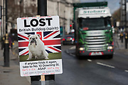 As Prime Minister Theresa May again meets opposition Labour leader Jreemy Corbyn in an attempt to break the deadlock in parliament of Brexit, a Brexiteer placard and an HGV lorry opposite parliament in Westminster, on 4th April 2019, in London, England.