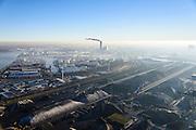 Nederland, Noord-Holland, Amsterdam, 11-12-2013; Westelijk Havengebied, Westhaven. Bergen steenkool en erts bij Overslag Bedrijf Amsterdam (OBA). Centrale Heweg (kolengestookt) in de achtergrond.<br /> Western Harbour Amsterdam, Westhaven. Mountains of coal and ore Overslagbedrijf Amsterdam (OBA), Transshipment Compagny. Electricityplant, coal fired, in the background.<br /> luchtfoto (toeslag op standaard tarieven);<br /> aerial photo (additional fee required);<br /> copyright foto/photo Siebe Swart.