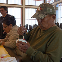 Church Rock elder Joe Begay, 65, puts the finishing touches on a piggy bank has painted for his grandchildren at the Church Rock Senior Center on Thursday