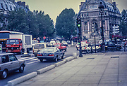 Old photo of traffic in city centre of Paris in 1987, France