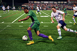 06 June 2015. New Orleans, Louisiana.<br /> National Premier Soccer League. NPSL. <br /> Ryan Reid of the New Orleans Jesters takes on Chattanooga FC in a Conference game at home in the Pan American Stadium. Chattanooga take a 4-0 victory over the Jesters.<br /> Photo; Charlie Varley/varleypix.com