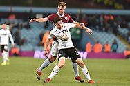 Swansea City midfielder Daniel James (20) battles for possession  with Aston Villa defender James Bree (16) during the The FA Cup 3rd round match between Aston Villa and Swansea City at Villa Park, Birmingham, England on 5 January 2019.