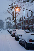 A still and snowbound street in Dulwich, South London, the morning after yet another overnight bad weather.