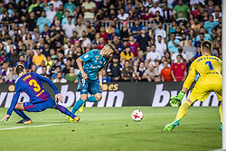 August 13, 2017 - Barcelona, Catalonia, Spain - Real Madrid forward BENZEMA competes with FC Barcelona defender PIQUE for the ball during the Spanish Super Cup Final 1st leg between FC Barcelona and Real Madrid at the Camp Nou stadium in Barcelona (Credit Image: © Matthias Oesterle via ZUMA Wire)