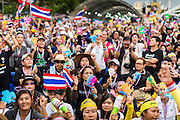 """15 NOVEMBER 2013 - BANGKOK, THAILAND:  Tens of thousands of Thais packed the area around Democracy Monument in the old part of Bangkok Friday night to protest against efforts by the ruling Pheu Thai party to pass an amnesty bill that could lead to the return of former Prime Minister Thaksin Shinawatra. Protest leader and former Deputy Prime Minister Suthep Thaugsuban announced an all-out drive to eradicate the """"Thaksin regime."""" The protest Friday was the biggest since the amnesty bill issue percolated back into the public consciousness. The anti-government protesters have vowed to continue their protests even though the Thai Senate voted down the bill, thus killing it for at least six months.     PHOTO BY JACK KURTZ"""