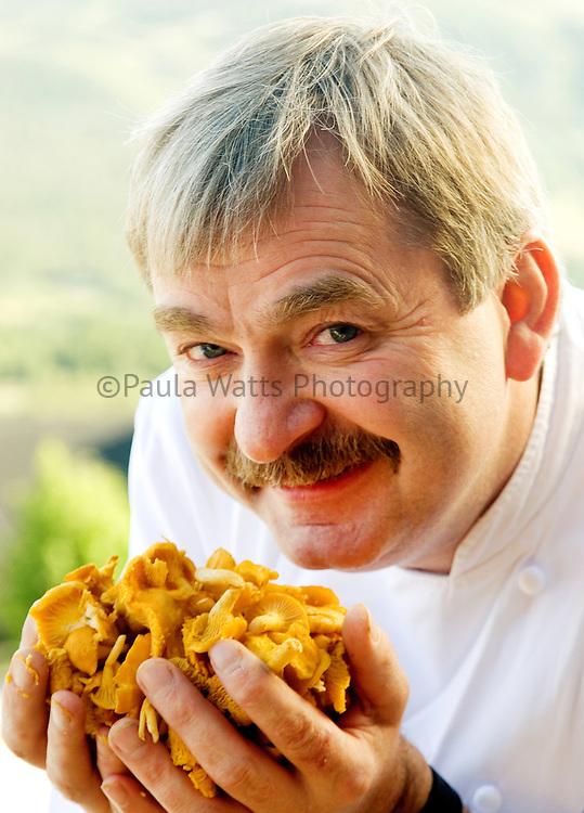 Head chef holding fresh chanterelle mushrooms