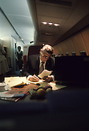 Reagan works on a speech on the campaign chart (United Airlines) during the campaign in 1976..Photograph by Dennis Brack BB31