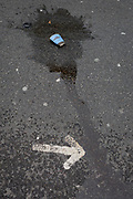 A detail of a puddle and dribble of spilled and squashed Caffe Nero coffee, on 5th January 2019, in London, England.