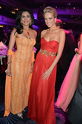 Left to right, PETRA NEMCOVA and LADY WILNELIA FORSYTH at the Caudwell Children's annual Butterfly Ball held at The Grosvenor House Hotel, Park Lane, London on 15th May 2014.