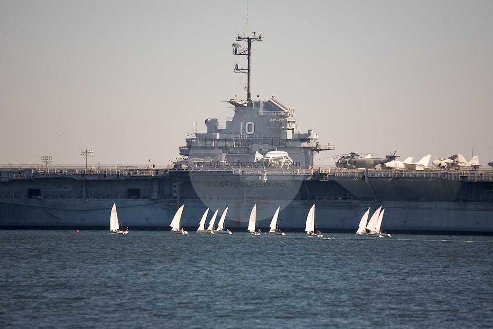 Sailboat race near the USS Yorktown aircraft carrier in Charleston harbor.