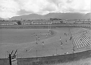 Dr. Eamonn O'Sullivan, the famed Kerry team trainer with his players in Fitzgerald Stadium, Killarney during this training session for the 1955 All-Ireland Football final.<br /> Photo by Harry MacMonagle<br /> <br /> from the MacMonagle, Killarney photo archive<br /> www.macmonagle.com