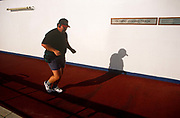 Half-way across the Gulf of Mexico, between Miami and Cancun in Mexico, a rather overweight passenger on Carnival Cruise's Fun Ship Ecstasy struggles to push his obese body around the ship's top Sun Deck Olympic jogging track. In evening tropical sunlight, the man runs while sweating and panting , punishing himself while listening to a portable Walkman music player (before the era of digital MP3s). Carnival's ships are known for their Las Vegas decor and entertainment, calling its vessels Fun Ships. The MS Ecstasy is a Fantasy class cruise ship featuring two pools, whirlpools, a variety of dining options, nightclubs, a casino, and duty-free shopping, catering to budget travel.
