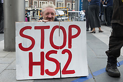 """London, UK. 5th August, 2021. Stop HS2 campaigner Scott Breen carries out outreach activities in front of a HS2 Routewide Roadshow at Kings Cross Square. There have been increasing doubts regarding the viability of the northern section of the HS2 high-speed rail link since a recent report published by the Infrastructure and Projects Authority gave Phase 2b the lowest 'red' rating, indicating that successful delivery of the scheme """"appears to be unachievable""""."""