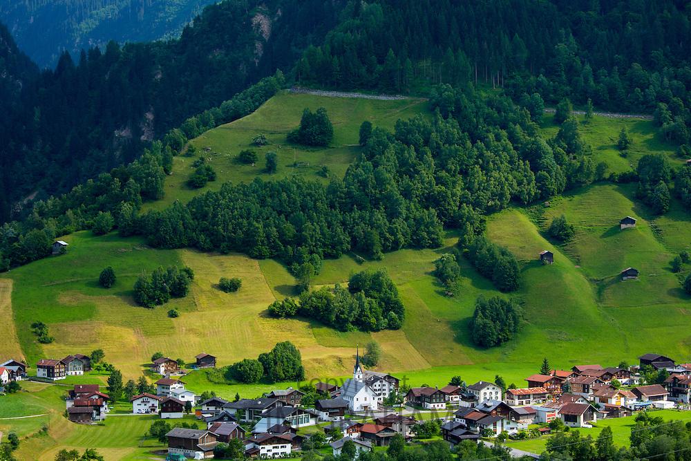 Swiss scene church and village of Surrein in mountain pass in the Graubunden region of Switzerland