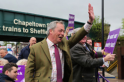 © Licensed to London News Pictures. 25/05/2016. Chapeltown, UK. Nigel Farage waves to the public as he rides atop the UKIP Referendum open top bus in Chapeltown, South Yorkshire. The party's purple open top battle bus is touring the country in the run up to the EU referendum. There is just a month to go until the UK's referendum on it's membership of the European Union. Poll stations will open their doors on Thursday 23 June. Photo credit : Ian Hinchliffe/LNP