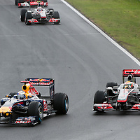 McLaren Formula One driver Lewis Hamilton (R) of Britain tries to overtake Red Bull Racing Formula One driver Sebastian Vettel (L) of Germany during the Hungarian F1 Grand Prix in Mogyorod (about 20km north-east from Budapest), Hungary. Sunday, 31. July 2011. ATTILA VOLGYI